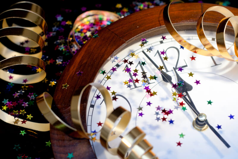 Family Fun New Year's Eve Party Ideas. New Years Party Background. Clock and festive tinsels