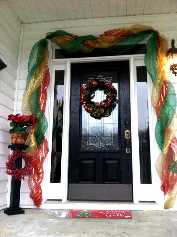 TOTS Family, Parenting, Kids, Food, Crafts, DIY and Travel door-3 Decorating Your Home for Christmas without Spending a Lot Home Style TOTS Family  wreath lights holiday entryway diy decorating craft bows