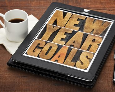 New Year goals - resolutions concept - text in vintage letterpress wood type on a digital tablet
