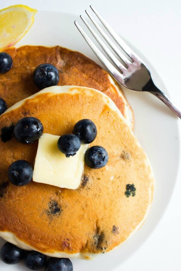 These fresh Lemon Blueberry Pancakes are bursting with fresh blueberries and have a hint of lemon flavor to them.