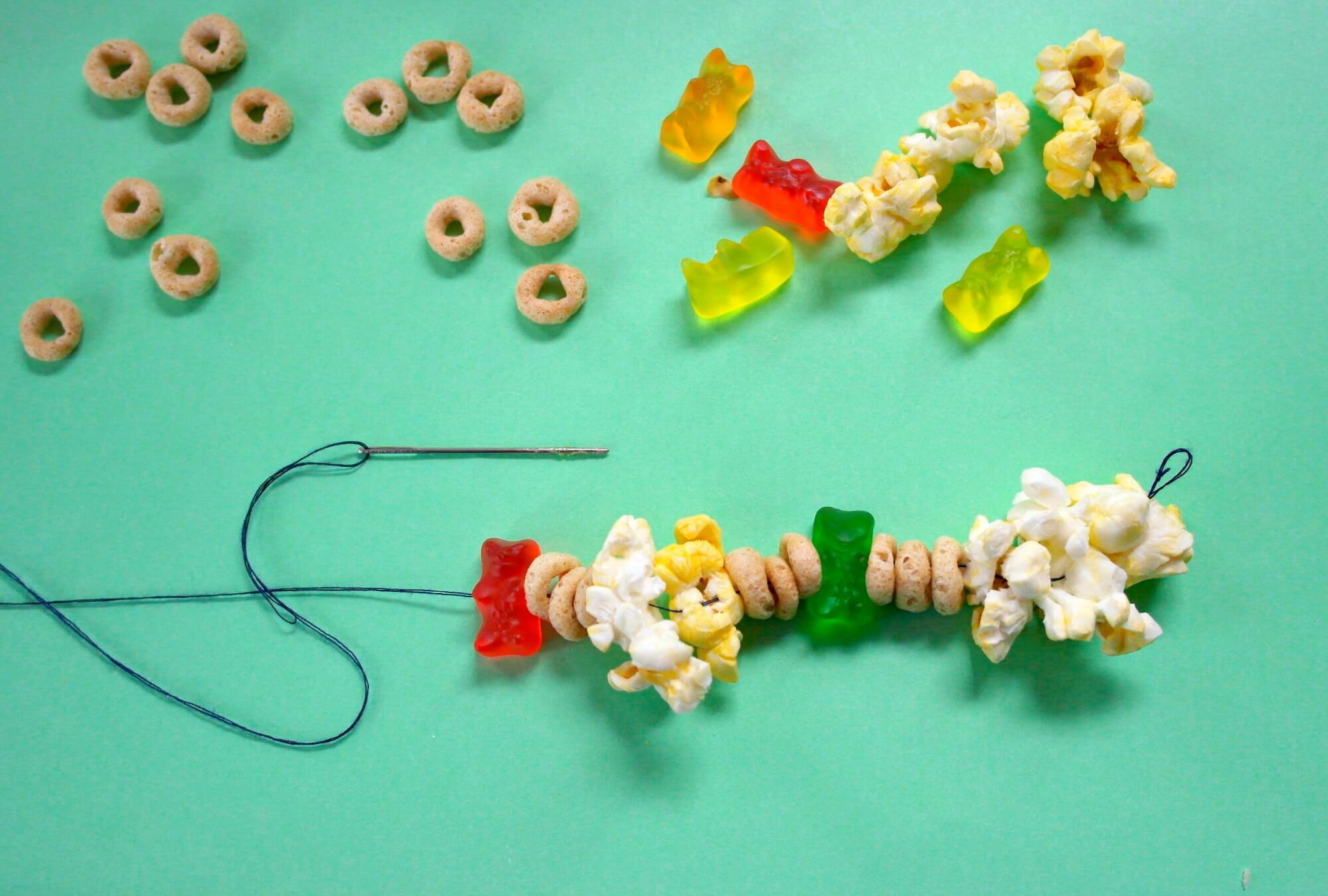 TOTS Family, Parenting, Kids, Food, Crafts, DIY and Travel popcorn-necklace-process-3 Easy Popcorn Candy Necklace Edible Craft Crafts Holiday Treats Kids TOTS Family  Popcorn Candy Necklace Edible Craft