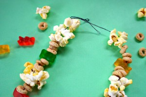 TOTS Family, Parenting, Kids, Food, Crafts, DIY and Travel popcorn-necklace-process-4-300x199 Easy Popcorn Candy Necklace Edible Craft Crafts Holiday Treats Kids TOTS Family  Popcorn Candy Necklace Edible Craft