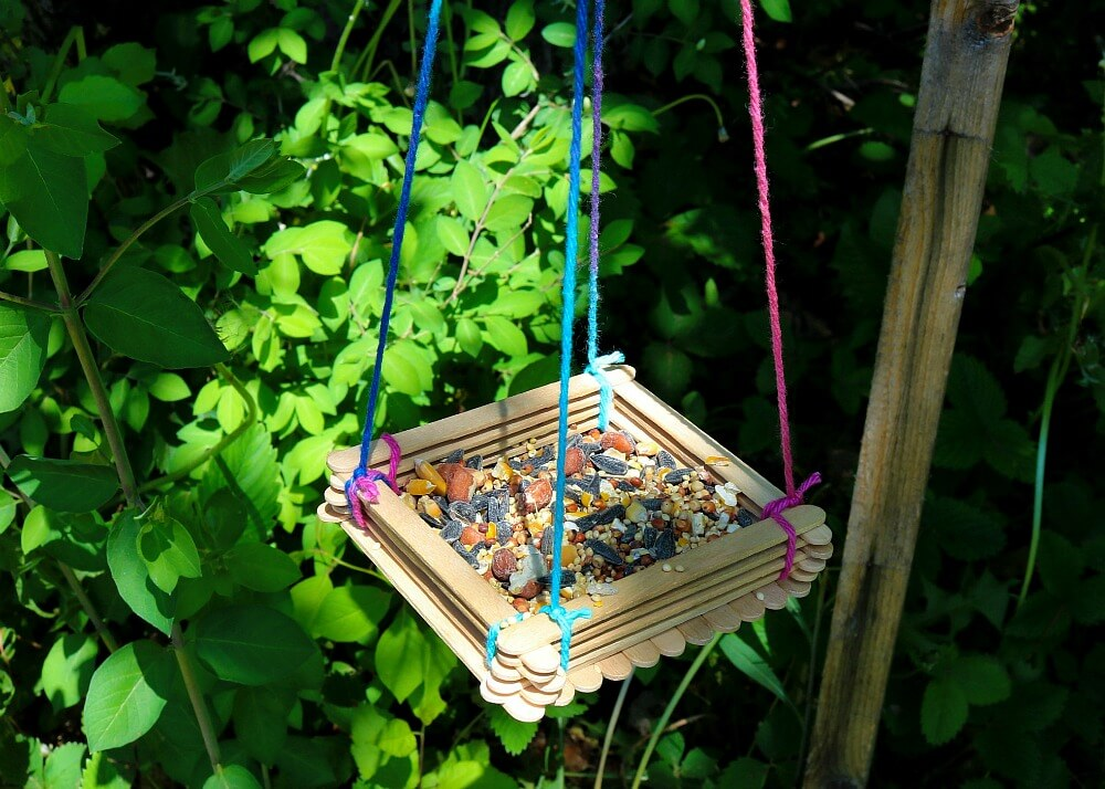 TOTS Family, Parenting, Kids, Food, Crafts, DIY and Travel feeder-horizontal- Craft Stick Bird Feeder Crafts Home Kids TOTS Family Uncategorized  kids craft birds bird feeder
