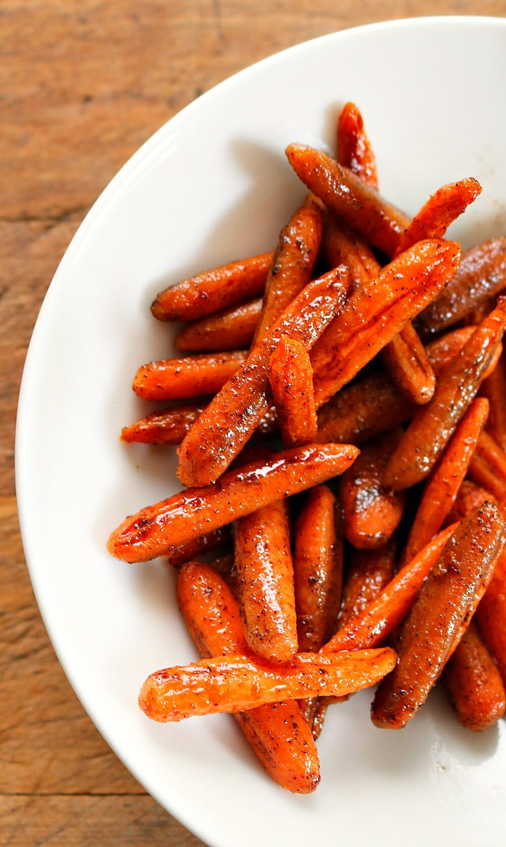 Normally I boil them on the stove and add some butter but this recipe for Honey Glazed Oven Roasted Carrots is our new favorite.