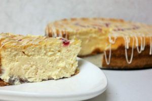 Baked White Chocolate Cheesecake Recipe with a Raspberry Drizzle Heart