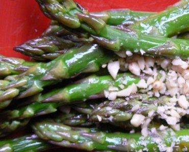 Warm Asparagus Spears with Pine Nuts - Tender, but not overcooked asparagus is often a fine art.