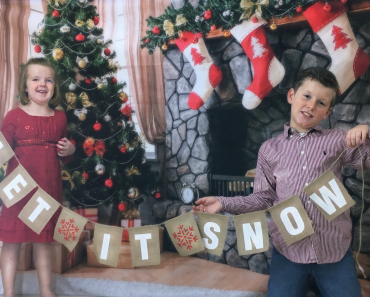 My kids with our Let-it-snow banner