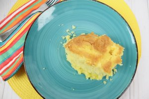 Lemon Dump Cake Recipe baked and ready to eat on a plate