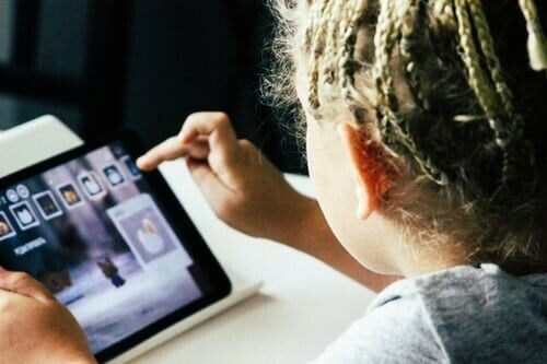 How Do I Monitor Screen time with my Children? photo of child looking at a tablet