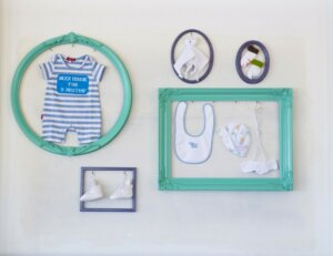 image of baby gifts hanging on a wall - Baby Thank You Cards