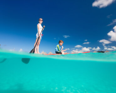 mother and son on a paddle board is one of 10 Outdoor Activities for the Whole Family
