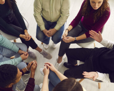 Diverse people meet, talk, get help and support, deal with psychological problems together. From above view young and senior patients listening to therapist, sitting in circle in group therapy session - Diverse people meet, talk, get help and support, deal with psychological problems together. From above view young and senior patients listening to therapist, sitting in circle in group therapy session
