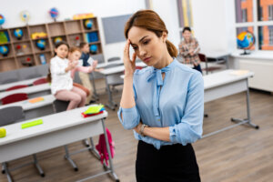 Tired teacher with Common Health Problems Experienced by Teachers